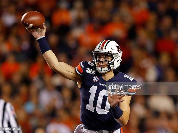 Bo Nix of the Auburn Tigers passes against the Mississippi Rebels in the first half at JordanHare Stadium on November 02 2019 in Auburn Alabama