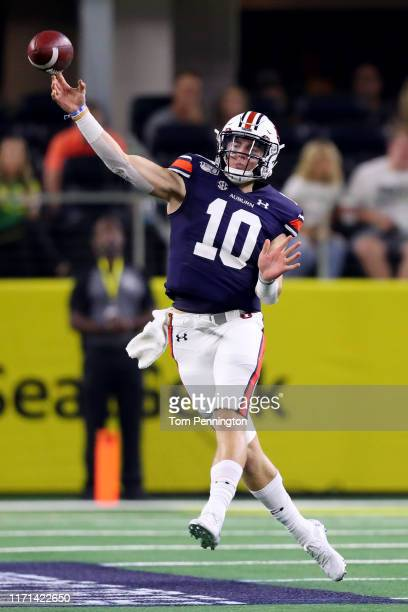 Bo Nix of the Auburn Tigers passes the ball against the Oregon Ducks in the second quarter during the Advocare Classic at ATT Stadium on August 31...