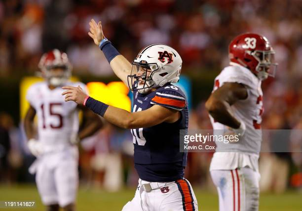 Bo Nix of the Auburn Tigers reacts after drawing the Alabama Crimson Tide offside on 4th and 4 to seal their 4845 win at Jordan Hare Stadium on...
