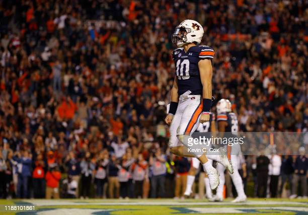 Bo Nix of the Auburn Tigers reacts after rushing for a touchdown in the second half against the Georgia Bulldogs at JordanHare Stadium on November 16...
