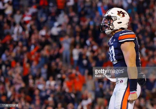 Bo Nix of the Auburn Tigers reacts after rushing for a touchdown in the second half against the Georgia Bulldogs at Jordan-Hare Stadium on November...