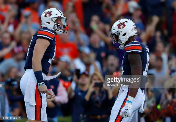 Bo Nix of the Auburn Tigers reacts after rushing for a touchdown against the Alabama Crimson Tide in the first half at Jordan Hare Stadium on...