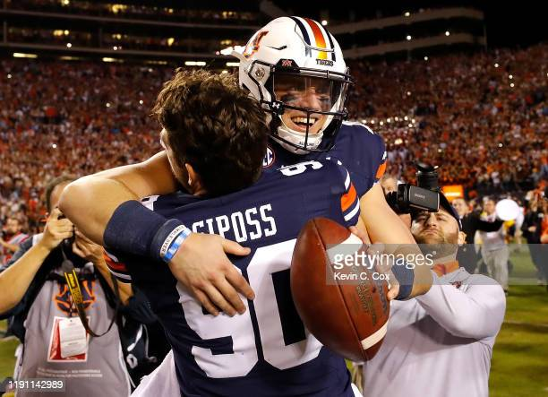 Bo Nix of the Auburn Tigers reacts after their 4845 win over the Alabama Crimson Tide with Arryn Siposs at Jordan Hare Stadium on November 30 2019 in...