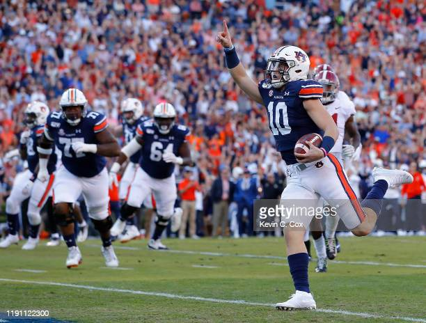 Bo Nix of the Auburn Tigers reacts as he rushes for a touchdown against the Alabama Crimson Tide in the first half at Jordan Hare Stadium on November...
