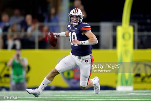 Bo Nix of the Auburn Tigers scrambles with the ball against the Oregon Ducks in the fourth quarter during the Advocare Classic at ATT Stadium on...