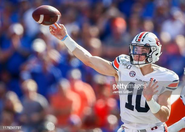 Bo Nix of the Auburn Tigers throws a pass during the first half of a game against the Florida Gators at Ben Hill Griffin Stadium on October 05 2019...