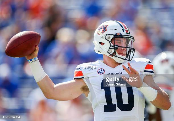 Bo Nix of the Auburn Tigers warms up before the start of a game against the Florida Gators at Ben Hill Griffin Stadium on October 05 2019 in...