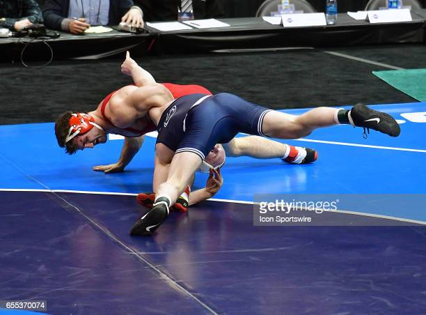 Bo Nokal pushes Gabe Dean of Cornell of the of the mat in the finals of the 184pound weight class of the NCAA Wrestling Championships on March 18 at...