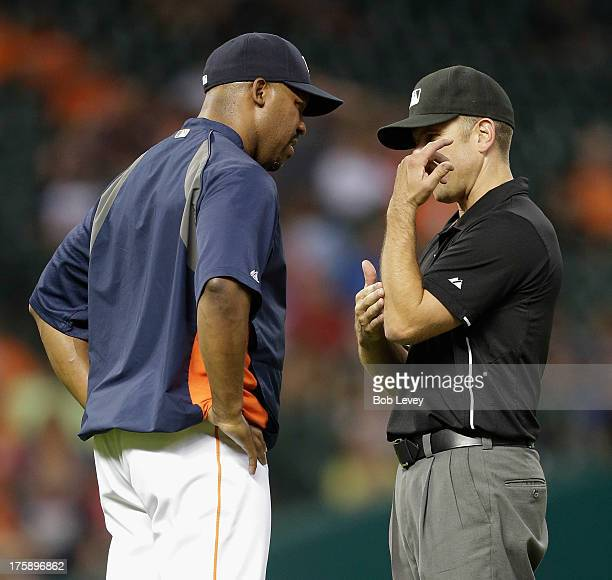 Bo Porter of the Houston Astros argues with second base umpire Chris Guccione as he shows Porter where Ian Kinsler of the Texas Rangers was tagged as...