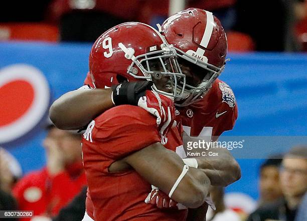 Bo Scarbrough of the Alabama Crimson Tide and Cam Robinson of the Alabama Crimson Tide celebrate after a touchdown during the 2016 ChickfilA Peach...