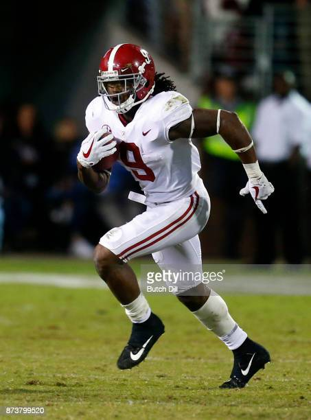 Bo Scarbrough of the Alabama Crimson Tide carries the ball during the second half of an NCAA football game against the Mississippi State Bulldogs at...