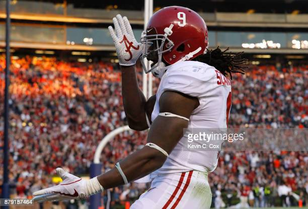 Bo Scarbrough of the Alabama Crimson Tide celebrates after rushing for a touchdown during the third quarter against the Auburn Tigers at Jordan Hare...