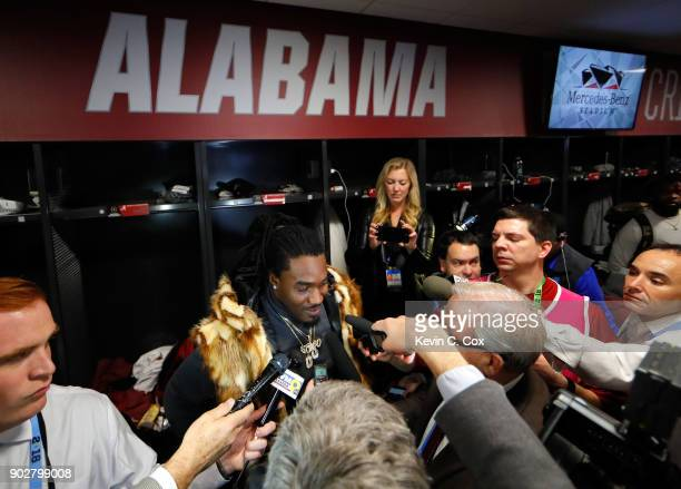 Bo Scarbrough of the Alabama Crimson Tide is interviewed in the locker room after beating the Georgia Bulldogs in overtime to win the CFP National...