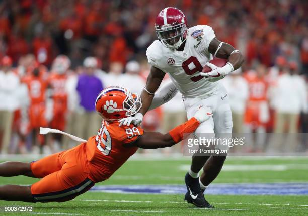 Bo Scarbrough of the Alabama Crimson Tide is tackled by Clelin Ferrell of the Clemson Tigers in the first half of the AllState Sugar Bowl at the...