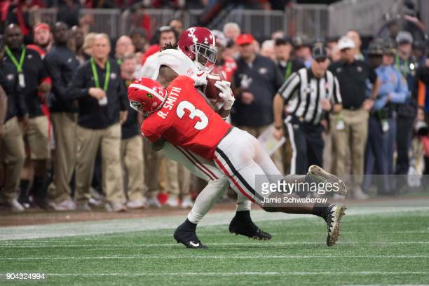 Bo Scarbrough of the Alabama Crimson Tide is tackles by Roquan Smith of the Georgia Bulldogs during the College Football Playoff National...