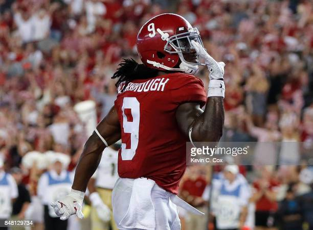 Bo Scarbrough of the Alabama Crimson Tide reacts after rushing for a touchdown past Josh Watson of the Colorado State Rams at Bryant-Denny Stadium on...