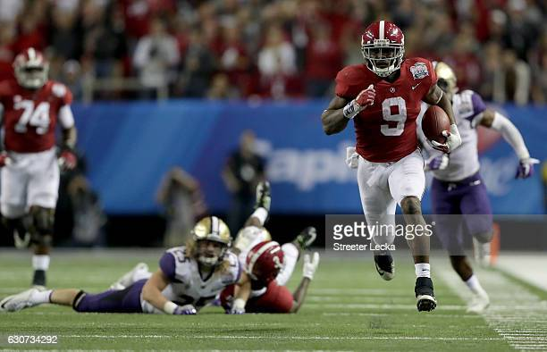 Bo Scarbrough of the Alabama Crimson Tide runs in a touchdown against the Washington Huskies during the 2016 Chick-fil-A Peach Bowl at the Georgia...