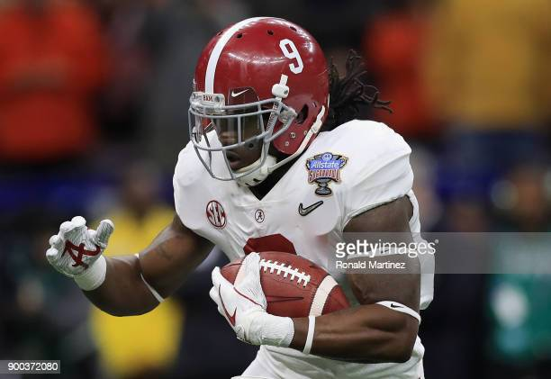 Bo Scarbrough of the Alabama Crimson Tide runs with the ball in the first quarter of the AllState Sugar Bowl against the Clemson Tigers at the...
