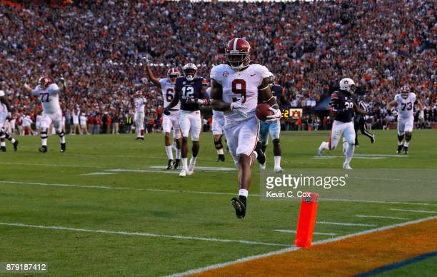 Bo Scarbrough of the Alabama Crimson Tide rushes for a touchdown during the third quarter against the Auburn Tigers at Jordan Hare Stadium on...