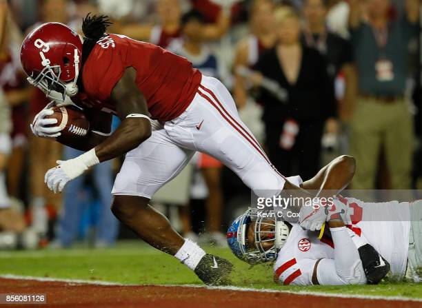 Bo Scarbrough of the Alabama Crimson Tide scores a touchdown against Detric BingDukes of the Mississippi Rebels at BryantDenny Stadium on September...