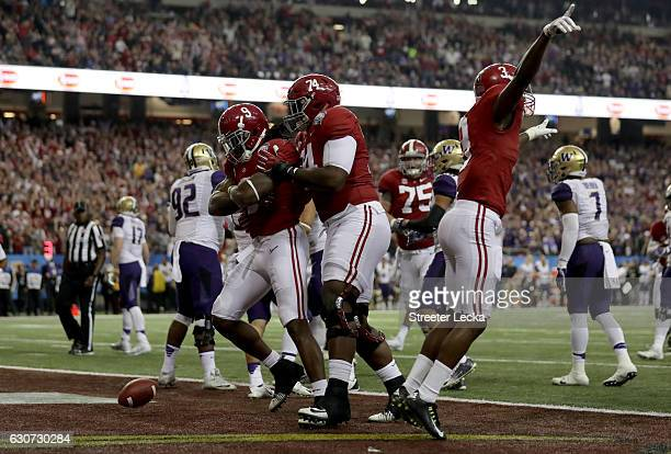 Bo Scarbrough of the Alabama Crimson Tide scores a touchdown during the 2016 Chick-fil-A Peach Bowl at the Georgia Dome on December 31, 2016 in...
