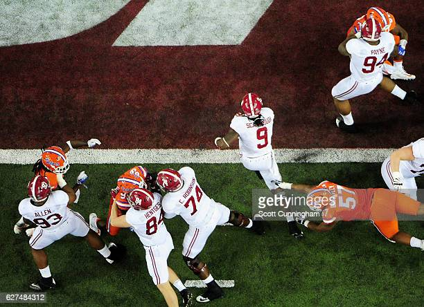 Bo Scarbrough of the Alabama Crimson Tide scores a touchdown in the second half against the Florida Gators during the SEC Championship game at the...