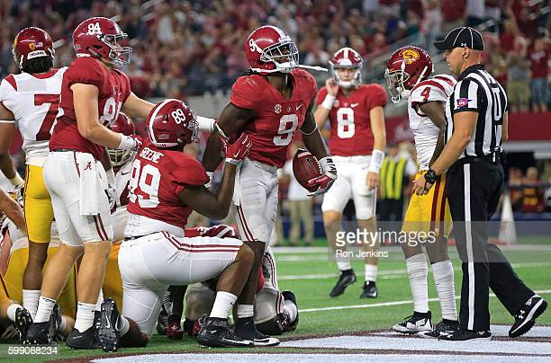 Bo Scarbrough of the Alabama Crimson Tide walks through the end zone after scoring a touchdown against the USC Trojans in the second half during the...