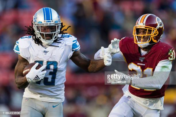Bo Scarbrough of the Detroit Lions attempts to fight off the tackle of Fabian Moreau of the Washington Redskins during the second half at FedExField...
