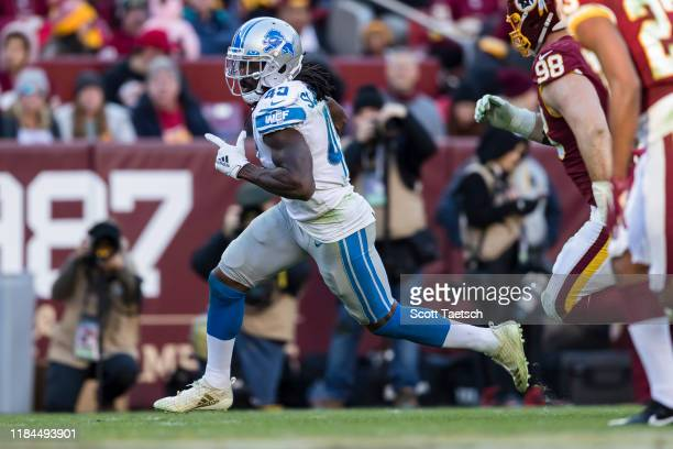 Bo Scarbrough of the Detroit Lions carries the ball against the Washington Redskins during the second half at FedExField on November 24, 2019 in...