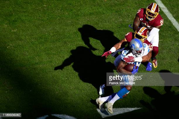 Bo Scarbrough of the Detroit Lions is tackled by Jon Bostic of the Washington Redskins in the first half at FedExField on November 24 2019 in...