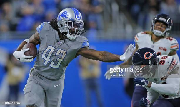 Bo Scarbrough of the Detroit Lions runs for a first down during the fourth quarter of the game against the Chicago Bears at Ford Field on November...