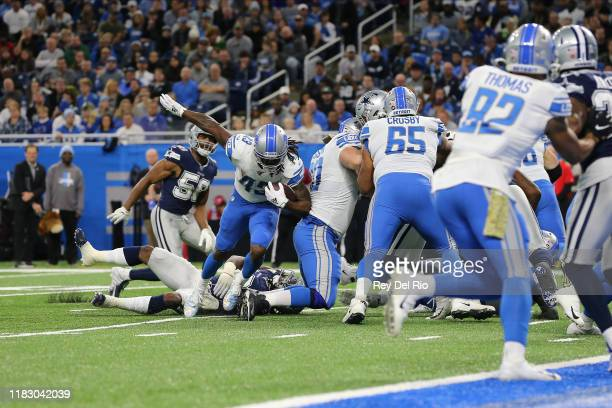 Bo Scarbrough of the Detroit Lions runs the ball for a touchdown in the first quarter against the Dallas Cowboysat Ford Field on November 17, 2019 in...
