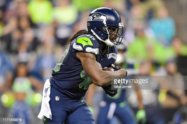 Bo Scarbrough of the Seattle Seahawks runs with the ball during the preseason game against the Oakland Raiders at CenturyLink Field on August 29,...