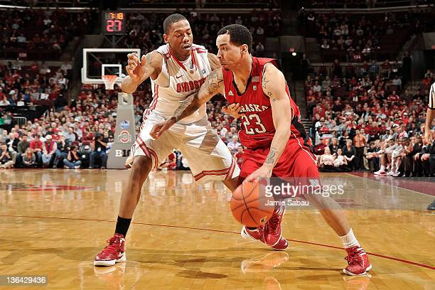 Bo Spencer of the Nebraska Cornhuskers dribbles around the Lenzelle Smith Jr #32 of the Ohio State Buckeyes on January 3 2012 at Value City Arena in...