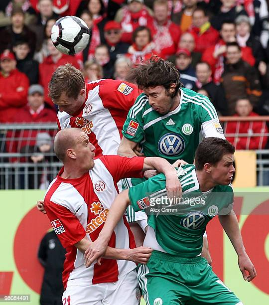 Bo Svensson , Miroslav Karhan of Mainz jump for a header with Andrea Barzagli and Alexander Madlung of Wolfsburg during the Bundesliga match between...