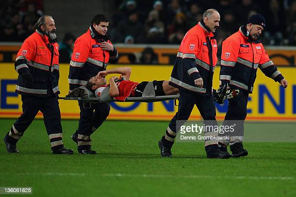 Bo Svensson of Mainz is carried off the pitch during the Bundesliga match between Borussia Moenchengladbach and FSV Mainz 05 at Borussia Park Stadium...