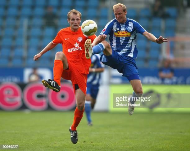 Bo Svensson of Mainz tackles Andreas Johansson of Bochum during the Bundesliga match between VfL Bochum and FSV Mainz at Rewirpower Stadium on...