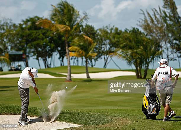 Bo Van Pelt hits out of the sand on the 11th hole during the third round of the Puerto Rico Open presented by Banco Popular held on March 22 2008 at...