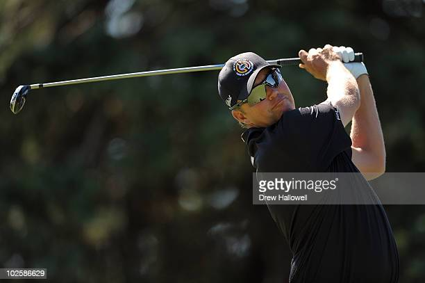 Bo Van Pelt watches his tee shot on the seventh hole during the second round of the AT&T National at Aronimink Golf Club on July 2, 2010 in Newtown...