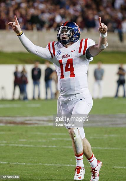 Bo Wallace of the Mississippi Rebels celebrates after tossing a 33yard third quarter touchdown pass during their game against the Texas AM Aggies at...