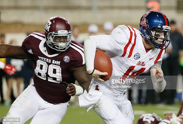 Bo Wallace of the Mississippi Rebels runs past Ivan Robinson of the Texas AM Aggies in the fourth quarterduring their game at Kyle Field on October...