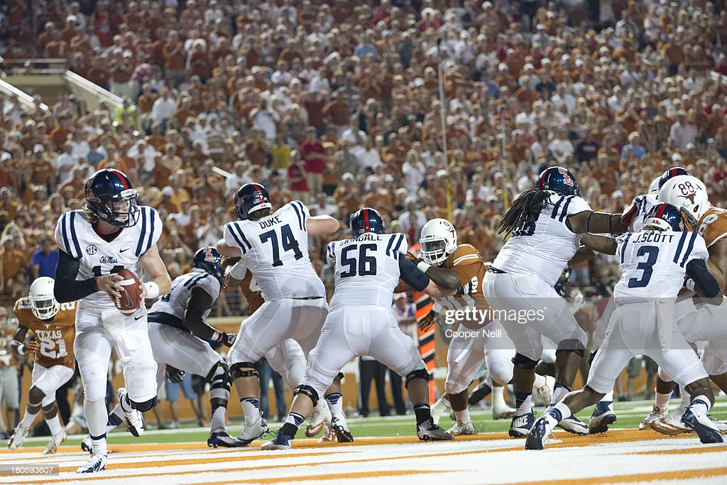 Bo Wallace #14 of the Mississippi Rebels scrambles in his own end zone against the Texas Longhorns on September 14, 2013 at Darrell K Royal-Texas Memorial Stadium in Austin, Texas.