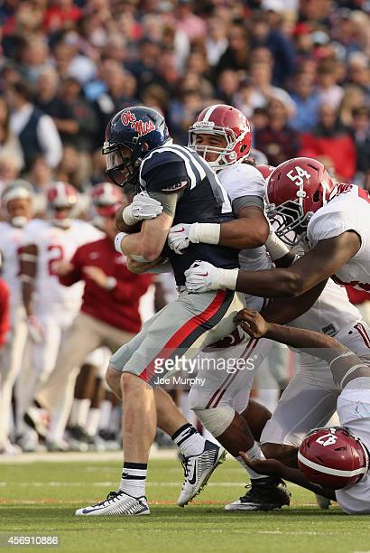 Bo Wallace of the Ole Miss Rebels is tackled by Trey DePriest Dalvin Tomlinson and Xzavier Dickson of the Alabama Crimson Tide on OCTOBER 4 2014 at...