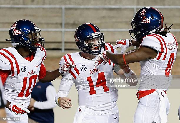 Bo Wallace Vince Sanders and Quincy Adeboyejo of the Mississippi Rebels celebrate after Wallace scored a fouryard touchdown during the first half of...
