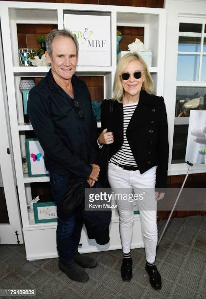 Bo Welch and Catherine O'Hara attend ROCK4EB at Private Residence on October 06 2019 in Malibu California