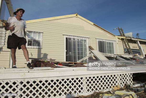 Bo Williams Glenn takes a break as he works on his damaged house on Port St Joe beach on October 12 two days after hurricane Michael hit the area...
