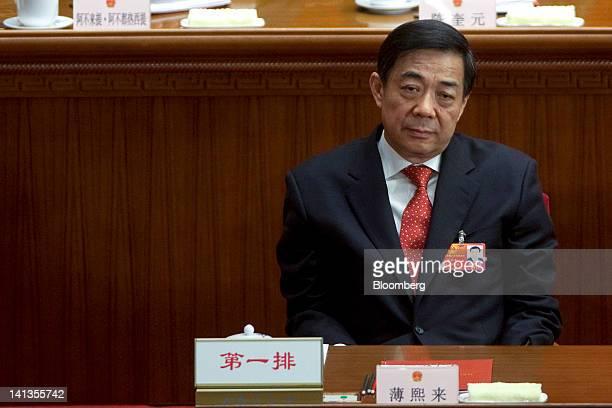 Bo Xilai then Chinese Communist Party secretary of Chongqing attends the closing ceremony of China's National People's Congress at the Great Hall of...