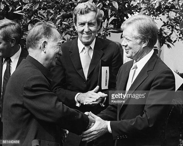 Bo Yibo VicePremier of the People's Republic of China shaking hands with US President Jimmy Carter at the White House Washington DC September 25th...