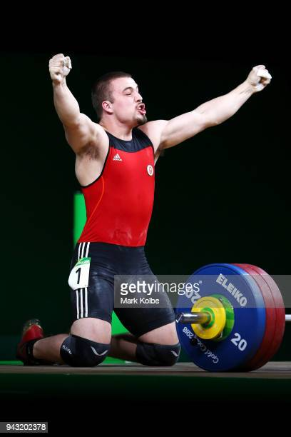 Boady Santavy of Canada celebrates a successful lift as he competes during Men's 94kg final of Weightlifting on day four of the Gold Coast 2018...
