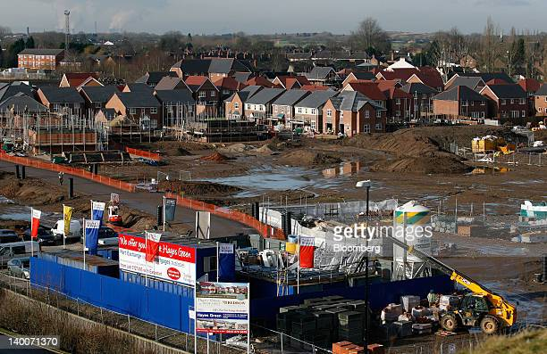 A board advertising new homes for sale sits outside the New Heritage Collection at Hayes Green development a joint venture between Redrow Plc and...